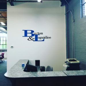Barton and Loguidice's new office at 639 Broadway, an old mill building in Newburgh that has been completely restored. Pictured is the reception area.