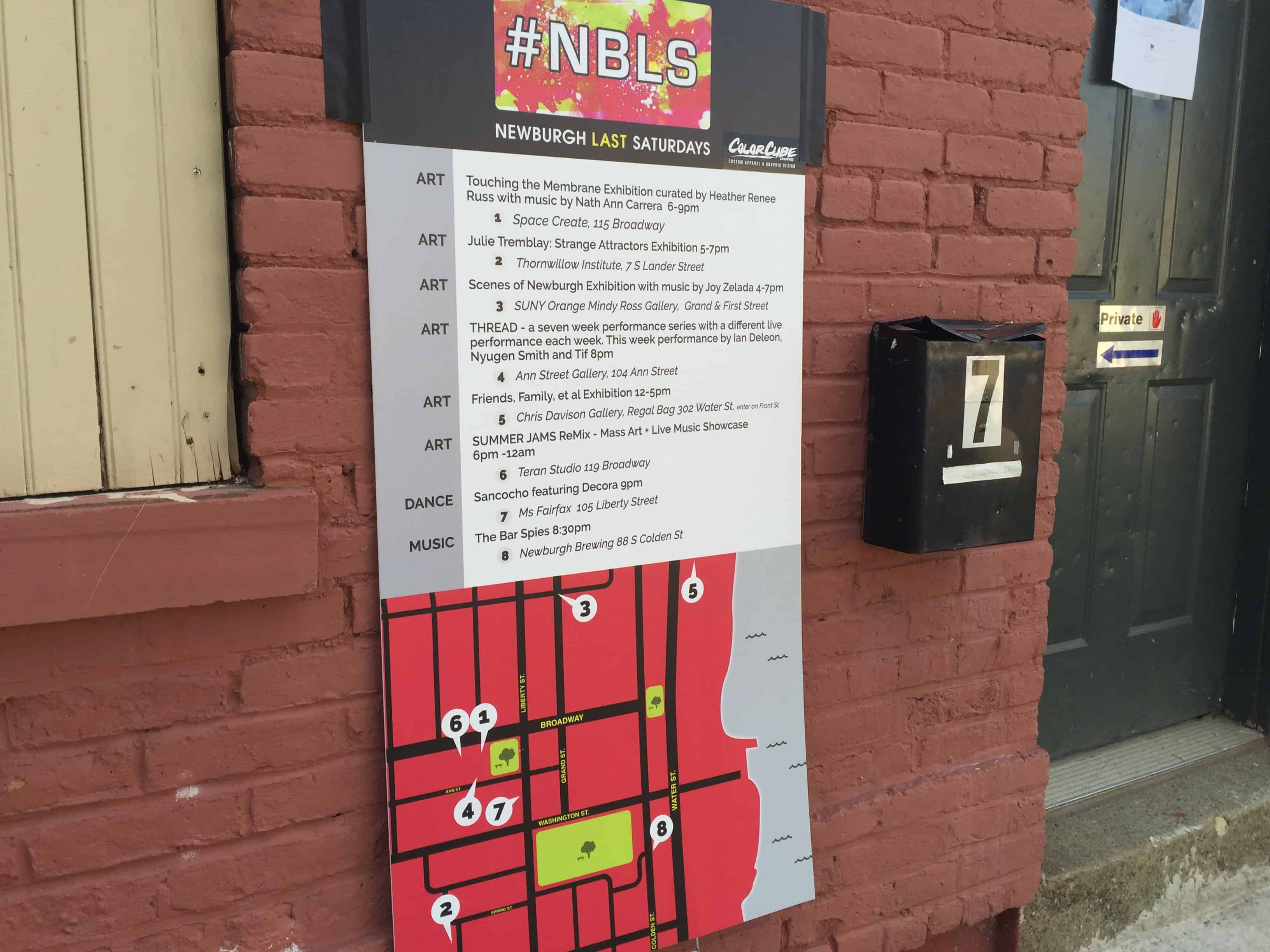 The well-designed map-key signage featuring the mark for #NBLS and a breakdown by type of the highlight events for May