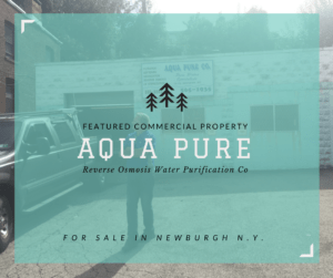 Rich Kodilanen stands outside his for-sale water purification business, Aqua Pure, located at 79 Renwick St., Newburgh, N.Y.