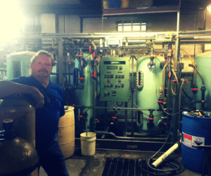 Rich Kodilanen stands in front of the water purification systems that drive his turn-key water purification company at 79 Renwick Street, Newburgh, N.Y. His building and his water purification business began opened for business in 1985.