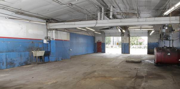 Potential garage space or storefront exposure