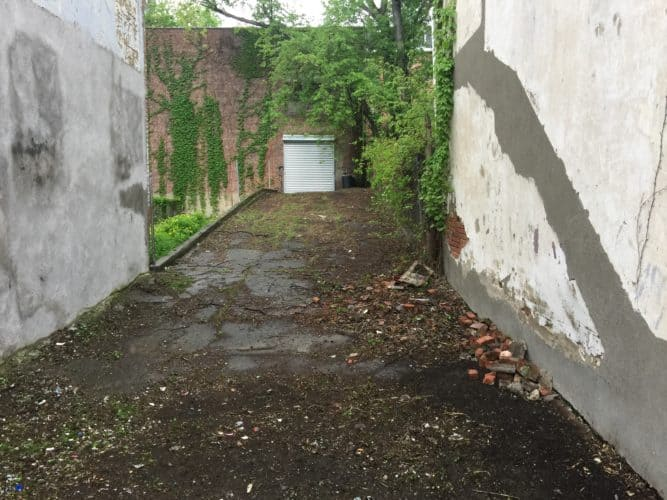 Side yard of 189 Lander Street Newburgh NY Garage/Automotive Use Building for Sale