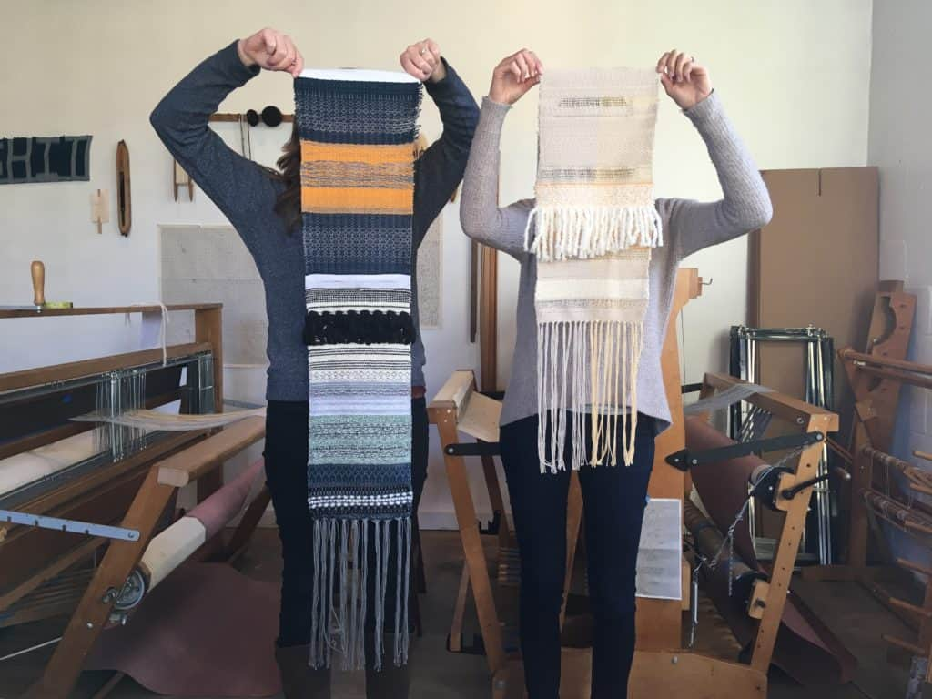 Participants hold scarves made in Newburgh weaving workshop