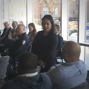 Isabel Rojas Program Manager of the District Attorney's Newburgh Group Violence Intervention surrounded by speakers from law enforcement and community members at a 2019 Call In