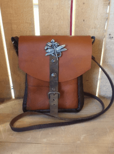 Hand-made leather goods manufacturer Elizabeth Collection's messenger bag manufactured in Newburgh N.Y. at the Orange County Accelerator's Newburgh Campus