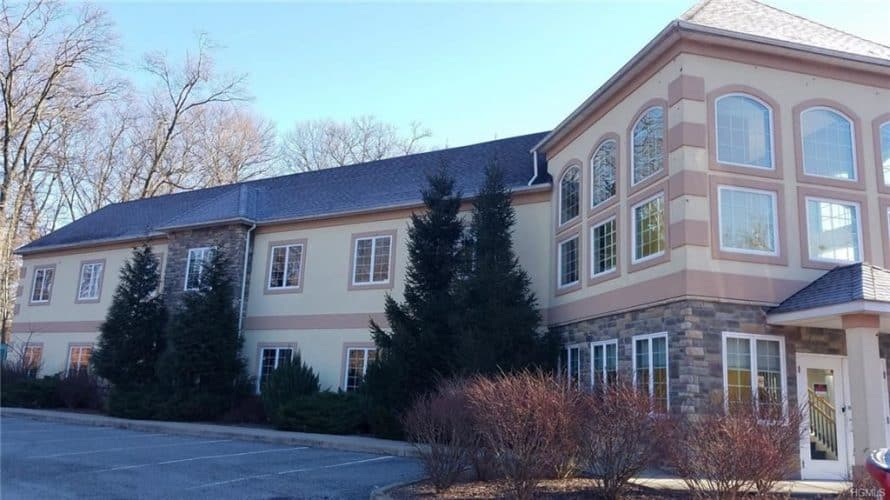 Office building for sale at 155 West Street in Newburgh, New York view from behind